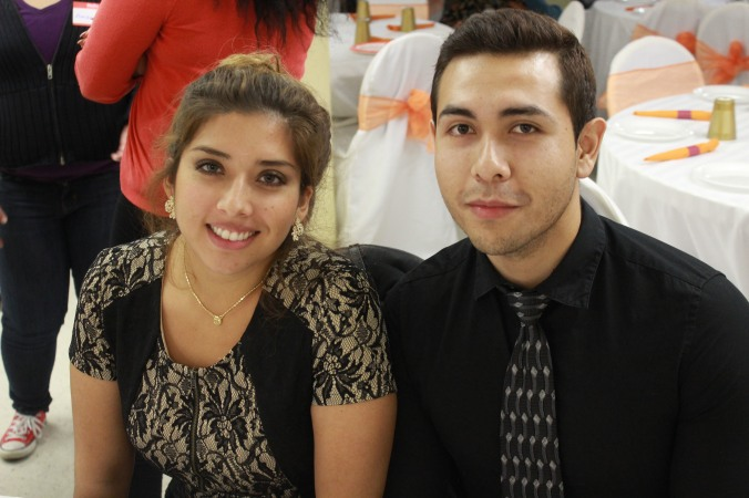 Katherine Parra (left) and Erick Pierola (right) enjoying Thanksgiving dinner together. Both are originally from Bolivia and arrived to the United States at the ages of 11 and 7, respectively.